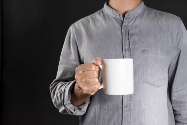 Man holding coffee mug stock photo
