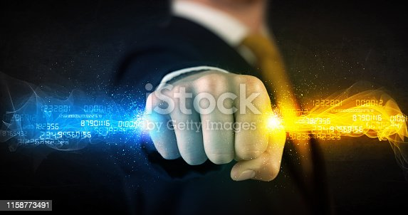 istock Man holding colorful glowing data in his hands 1158773491