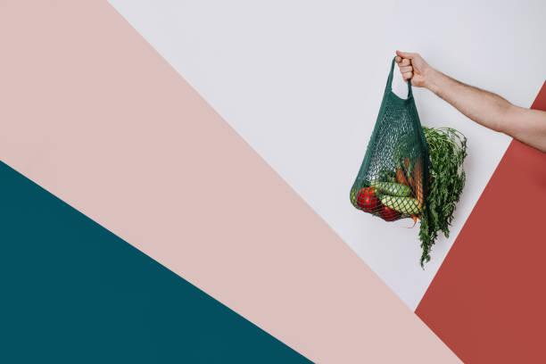 Man holding cotton shopping eco bag stock photo