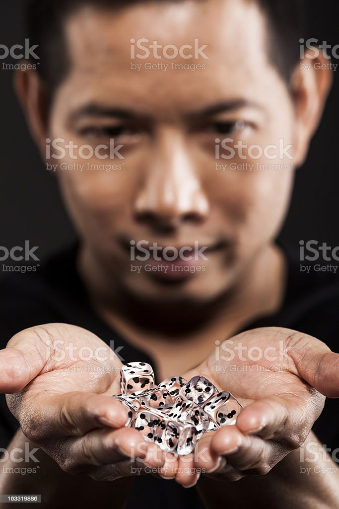 Man holding dices stock photo