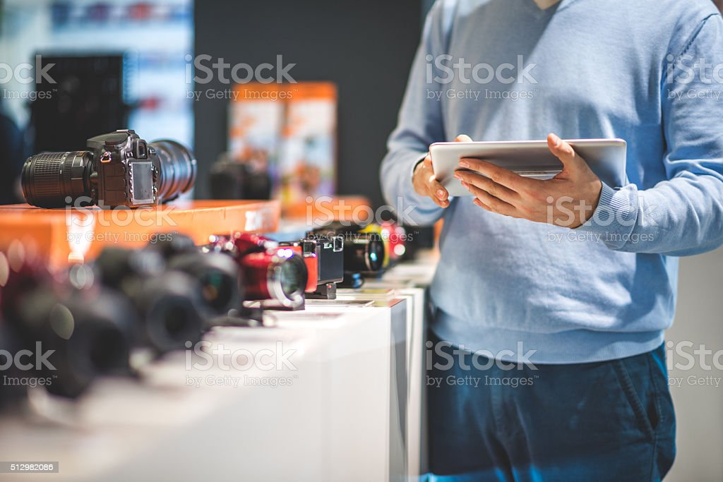 Man holding digital tablet stock photo