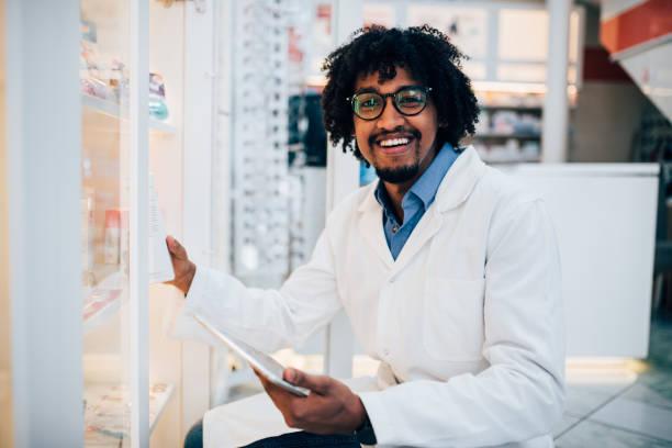 Man holding digital tablet when working in pharmacy stock photo