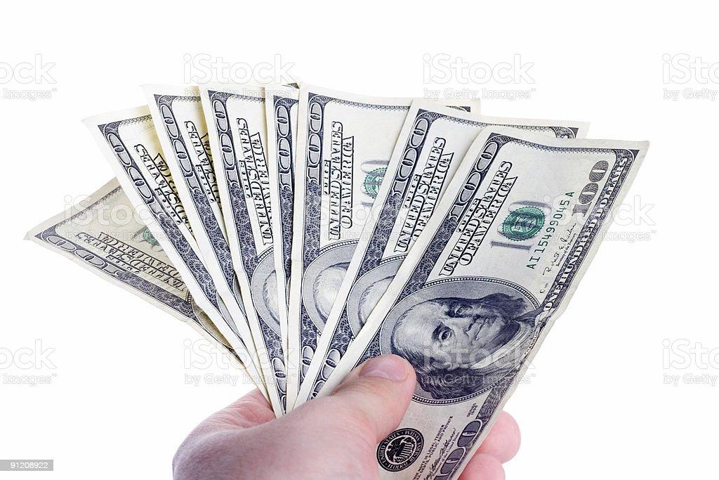 Man holding dollar bills royalty-free stock photo