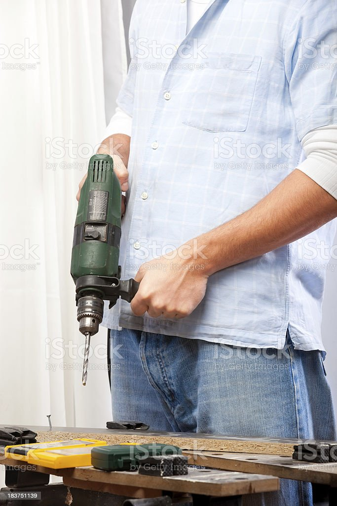 Man holding electric drill royalty-free stock photo