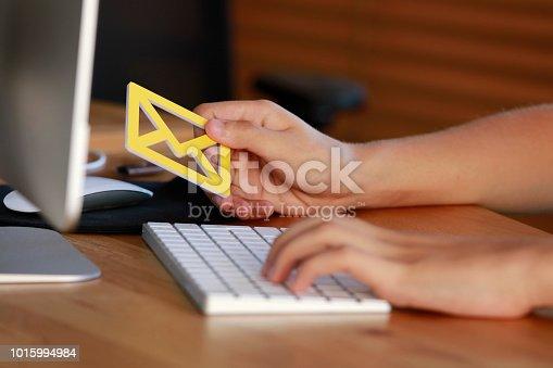 860524646 istock photo Man holding e-mail icon 1015994984