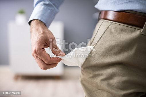 Close-up Of Young Man Showing Empty Pockets