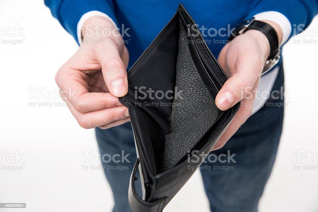 man holding emty wallet stock photo