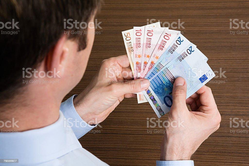 Man holding euros 免版稅 stock photo
