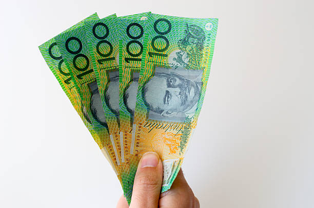 Man holding five hundred Australian Dollar banknote in his hands stock photo