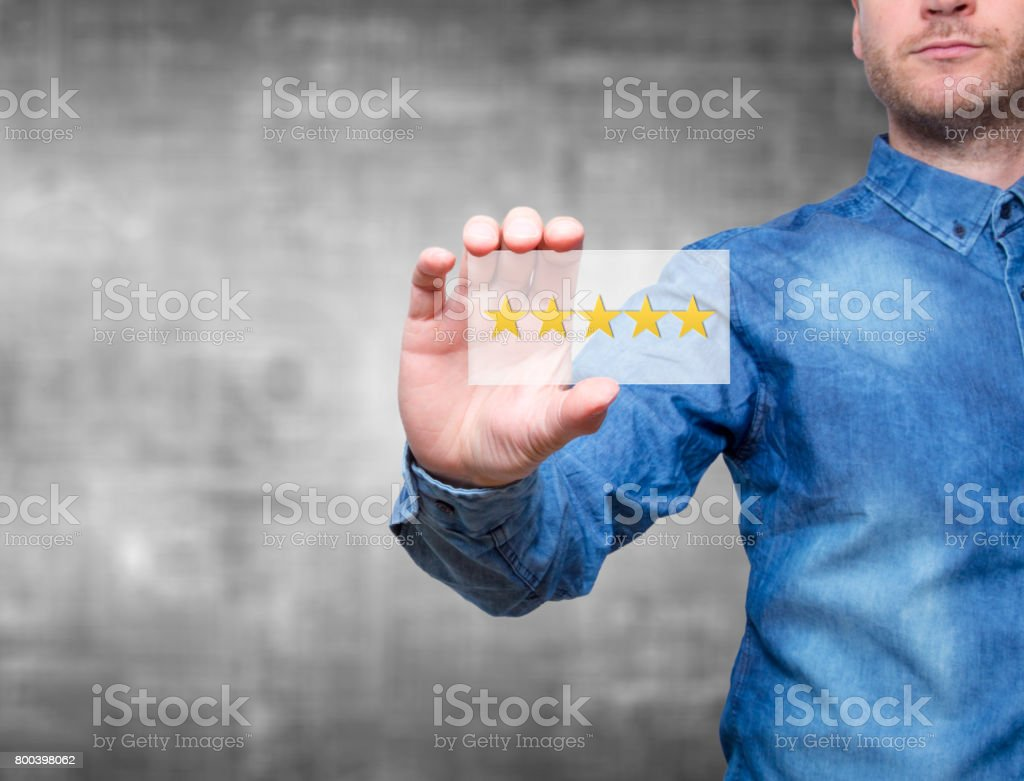 Man holding five star rating. Five stars service. Grey background - Stock Image royalty-free stock photo