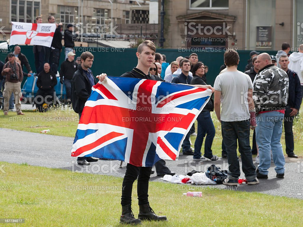 Man holding flag at the English Defence League rally royalty-free stock photo