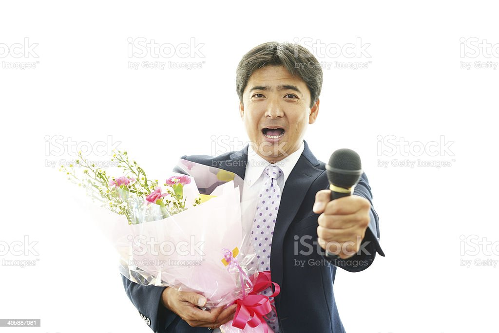 Man holding flower bouquet with mike stock photo