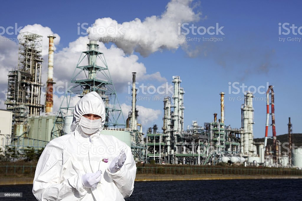 Man holding flower in front of factory royalty-free stock photo