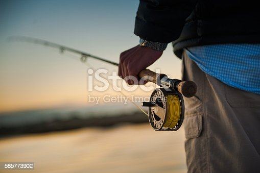 istock Man holding fly rod 585773902