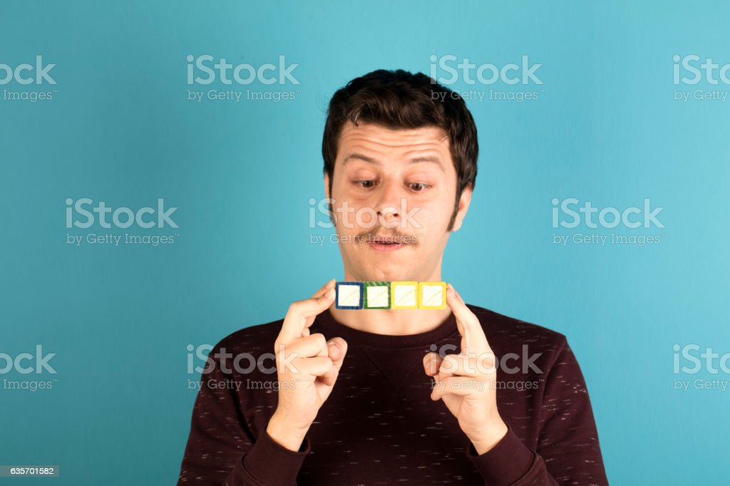 Man holding four toy blocks royalty-free stock photo