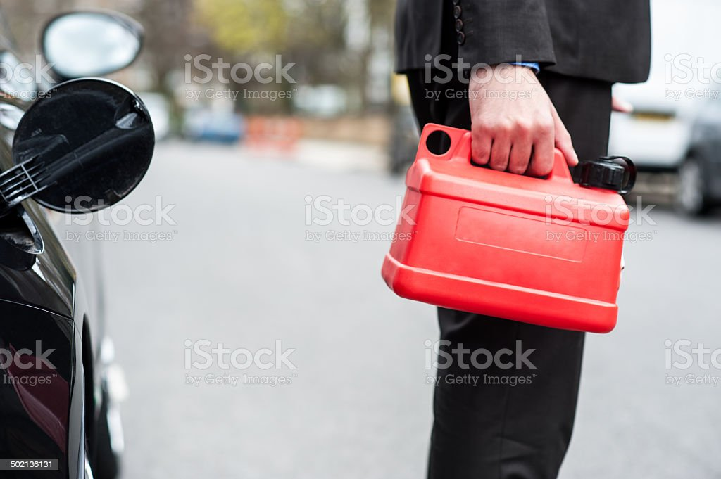 Man holding fuel can, cropped image stock photo