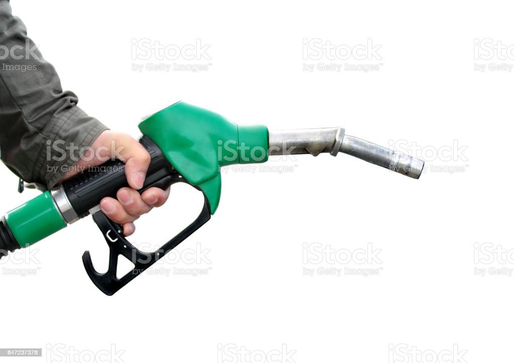 Homem que segura a bomba de combustível - foto de acervo
