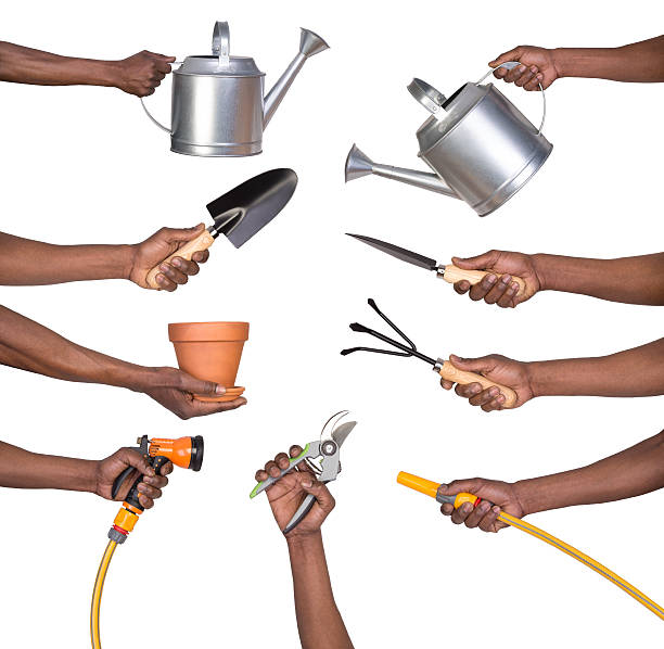 man holding gardening tools - garden hose stock pictures, royalty-free photos & images