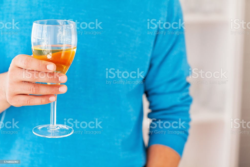 Man Holding Glass Of White Wine royalty-free stock photo