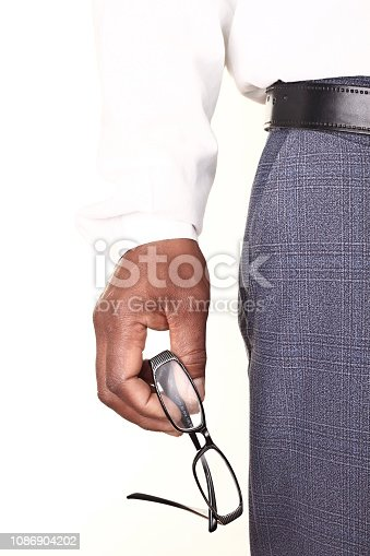 man holding glasses in an optician shop