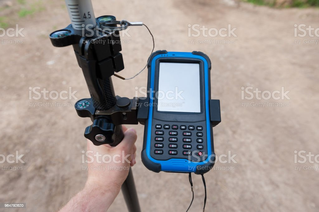 Man holding gps unit. Surveyor equipment. royalty-free stock photo
