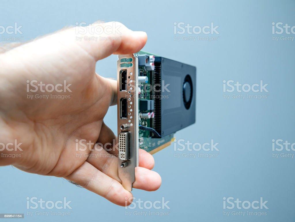 Man holding GPU Video card stock photo