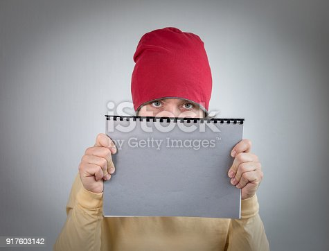 1139340462 istock photo Man holding gray notebook, free space for marketing information text 917603142