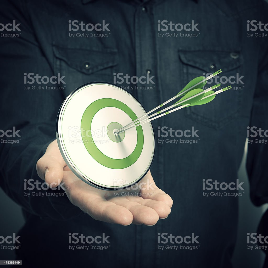 Man Holding Green Target - Marketing Solutions Concept royalty-free stock photo