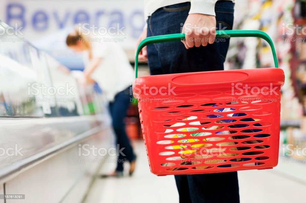 Man Holding Grocery Basket stock photo