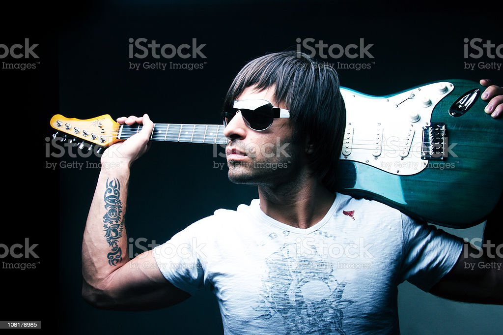 Man Holding Guitar Behind Head royalty-free stock photo