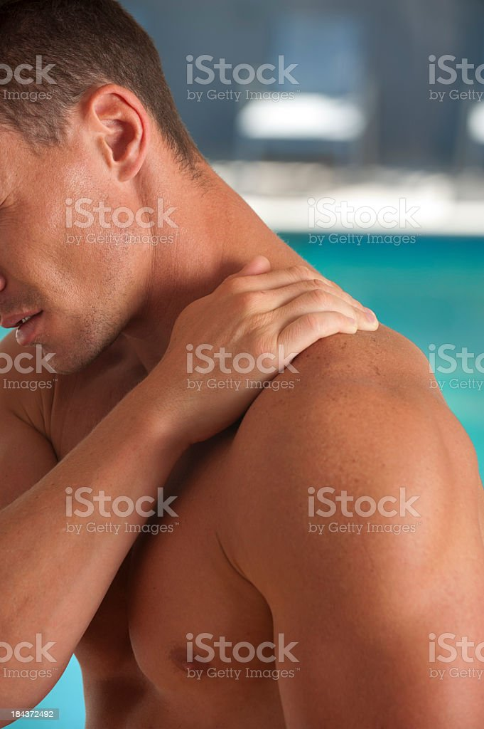 Man holding hand on his neck royalty-free stock photo