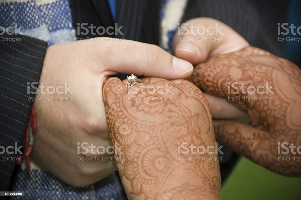 man holding hands of woman at a wedding royalty-free stock photo