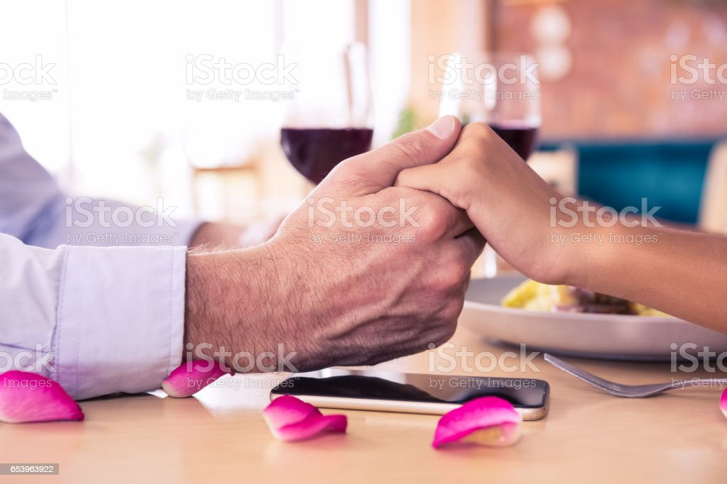 Man holding hands of woman stock photo