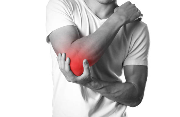 a man holding hands. pain in the elbow. the hearth is highlighted in red. close up. isolated on white background - infiammazione foto e immagini stock