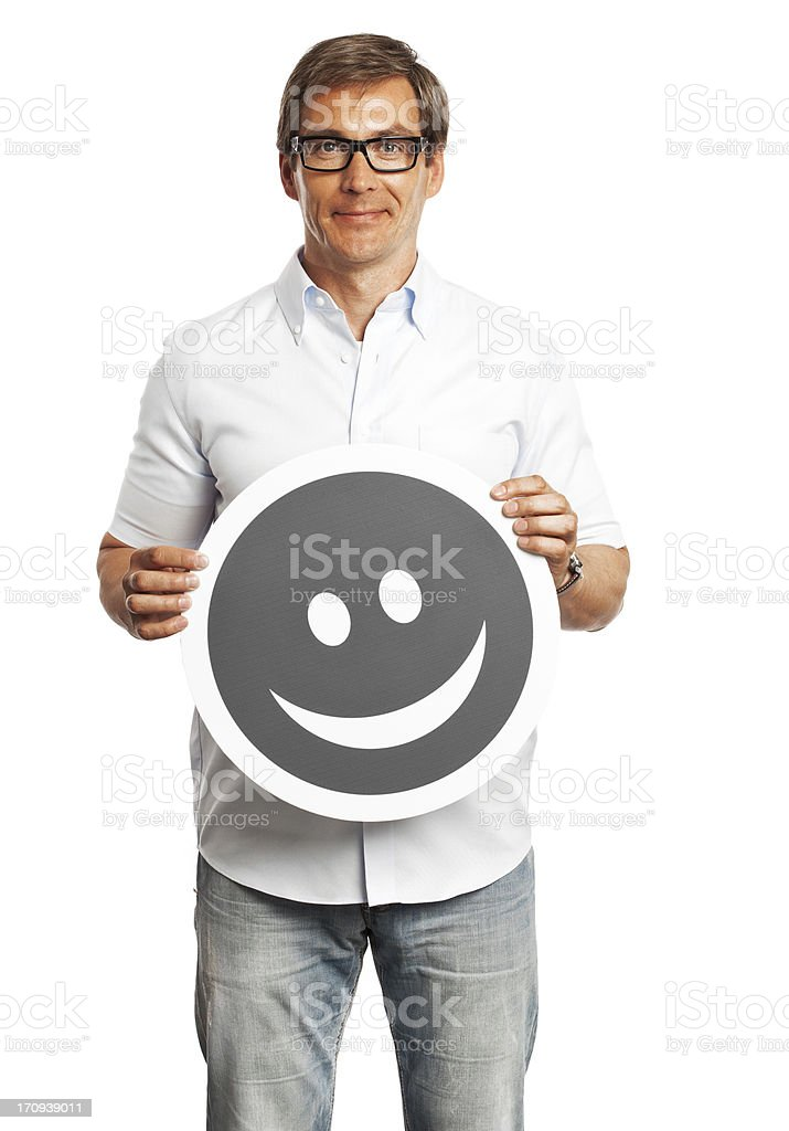 Man holding happy smile sign isolated on white background. royalty-free stock photo