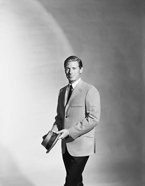 Man holding hat standing against grey background portrait picture id120989004?b=1&k=6&m=120989004&s=612x612&w=0&h=ddvdzvsoz6epjo3qztyvnznhu w5xpx9yqnjtxvcnsa=