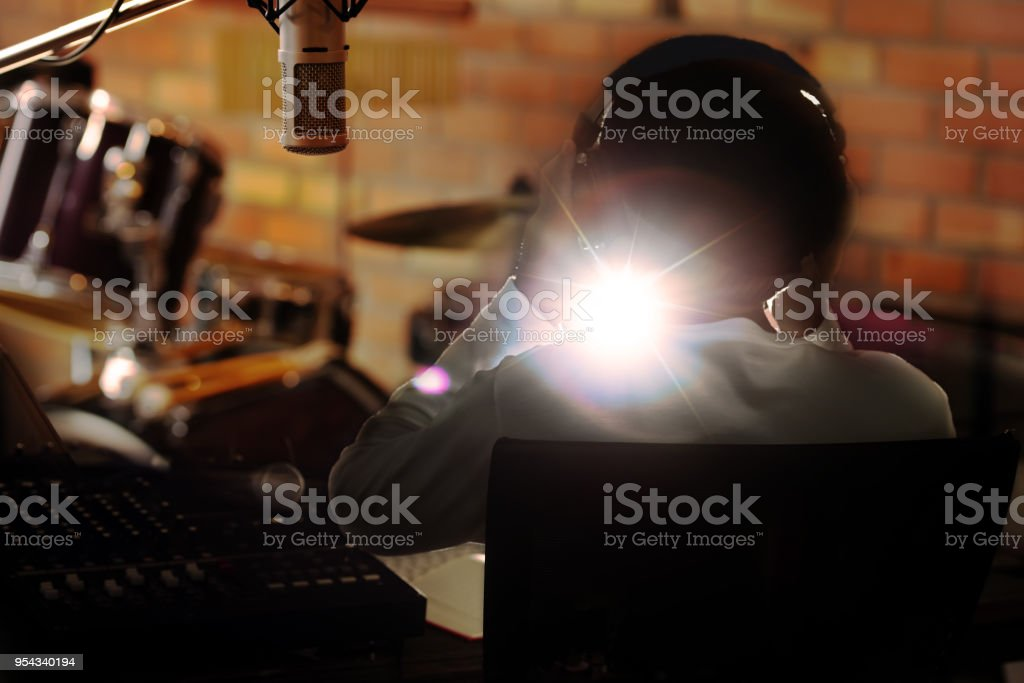 Man holding headphone listening to live sound . stock photo
