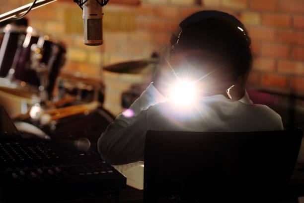 Man holding headphone listening to live sound . stock photo