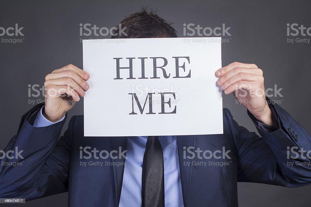Man Holding 'Hire Me!' stock photo