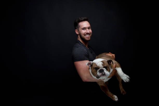 Man holding his cute bulldog picture id949306692?b=1&k=6&m=949306692&s=612x612&w=0&h=f3sjeqltrg2d5jf rr6jzlqutwb5k77g5jjs 02xuk4=