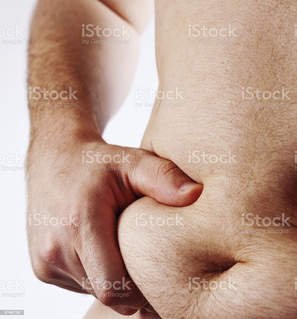 Man holding his fat belly isolated on white royalty-free stock photo