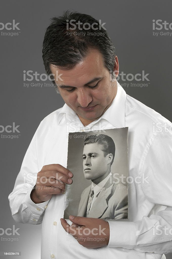 Man Holding His Father's Old Photo royalty-free stock photo
