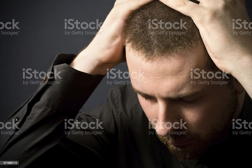 A man holding his hands to the top of his head  royalty-free stock photo