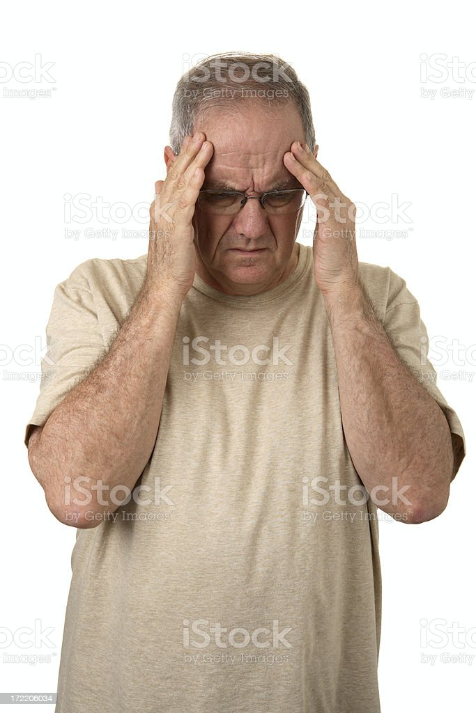 A man holding his head as if he is suffering a big headache royalty-free stock photo