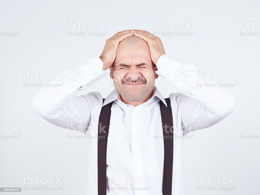 man holding his head pain. Closed eyes in pain. Headache. Migraine.