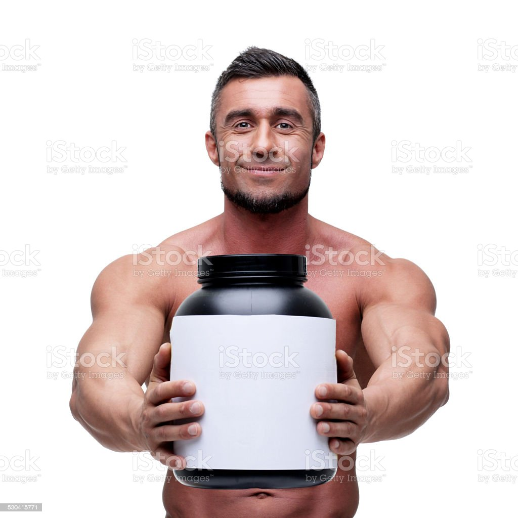 man holding holding jar with protein stock photo