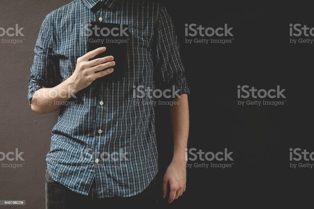 Man holding Holy bible. Prayer concept for faith spirituality and religion gray background - foto stock