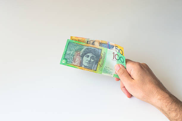 Man holding hundred and fifty Australian Dollar banknote stock photo