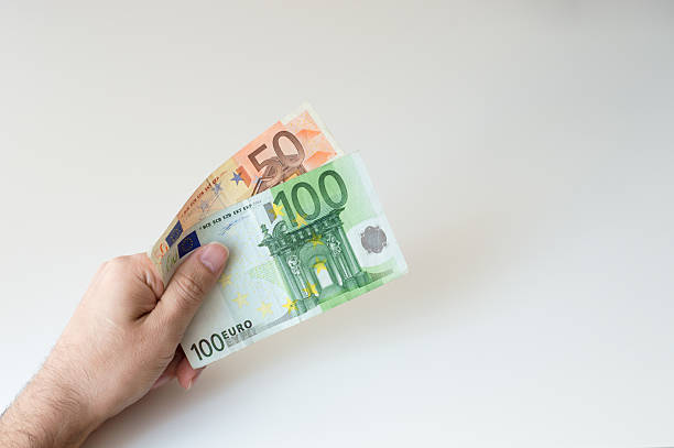 Man holding hundred and fifty Euro banknote in his hands stock photo