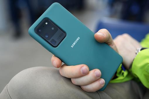 Minsk, Belarus - March 27, 2020: Man holding in hands Samsung Galaxy s20 Ultra closeup